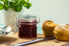 Raspberry jam in a jar. And muffins. selective focus Royalty Free Stock Photos