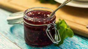 Raspberry jam in a jar. Selective focus Royalty Free Stock Photos