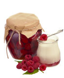 Raspberry jam in a jars and fresh berries. Glass of fresh delicious yogurt with berry fruits Stock Photography