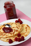 Raspberry jam on pancakes Royalty Free Stock Photography