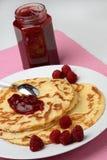 Raspberry jam on pancakes. Dessert Royalty Free Stock Photography