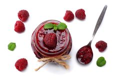 Raspberry jam with raspberry berries isolated on white background. top view Stock Images
