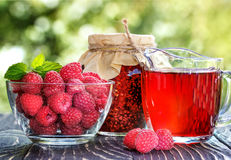 Raspberry jam,raspberry juice and fresh raspberry. On a rustic wooden table Royalty Free Stock Images