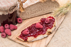 Raspberry Jam on rustic background Royalty Free Stock Photography