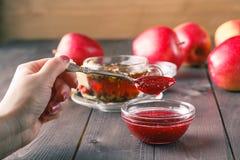 Raspberry jam in spoon Stock Photos