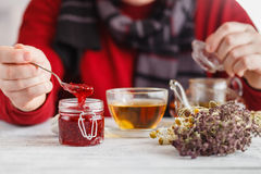 Raspberry jam in spoon on wooden table Royalty Free Stock Photography