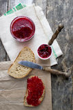 Raspberry jam on the table Stock Images