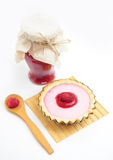 Raspberry jam, tart and wooden spoon with fruit Stock Photos