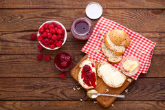Raspberry jam to smear on wooden rustic desk. Raspberry jam to smear. Raspberry jam Bread and butter. Jars of raspberry jam with berries on tray close up Stock Photography