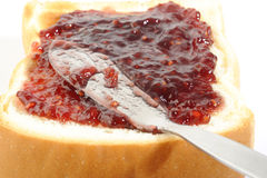Raspberry jam and toast Stock Photos