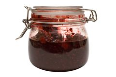 Raspberry Jam w/ Path (Side View). A closed glass of raspberry jam against white. File contains clipping path Stock Images