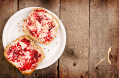 Raspberry jam on whole grain rolls Royalty Free Stock Images