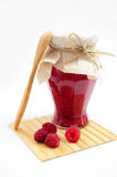 Raspberry jam with wooden spoon Royalty Free Stock Photo
