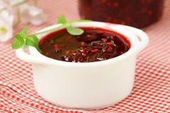 Raspberry jam on a wooden table Royalty Free Stock Photos