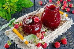 Raspberry jam on a wooden table in the garden Royalty Free Stock Photo