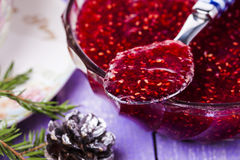 Raspberry jam on the wooden table Royalty Free Stock Image