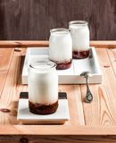 Raspberry jam yogurt. On a wooden table board stock images