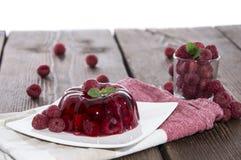 Raspberry Jello on white stock image