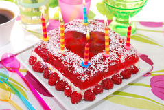 Raspberry jelly cake with birthday candles Stock Photos