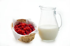 Raspberry and jug with milk Royalty Free Stock Photography