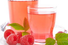 Raspberry juice and fresh raspberries. Glasses of raspberry juice and fresh raspberries on white background - close up Stock Images