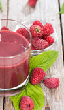 Raspberry Juice. Portion of fresh made Raspberry Juice with some fruits Royalty Free Stock Image