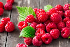 Raspberry. Juice summer fruits with leaves. Freshly picked Stock Photo