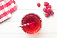 Raspberry juice. On white table Royalty Free Stock Images