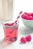 Raspberry juice. On white table Stock Photos