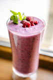 Raspberry and kefir smoothie. Healthy raspberry, mint and kefir smoothie in a glass stock image