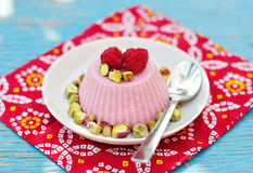 Raspberry Kulfi with Pistachios, Indian ice cream Royalty Free Stock Photo