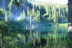 Raspberry Lake. Secluded lake located close to the California Oregon boarder Stock Photos