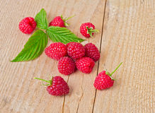 Raspberry with leaf on wooden table Royalty Free Stock Images