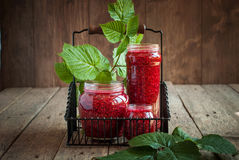 Raspberry Leaves and Jam in a jars on the wooden table. Horizontal image Stock Image
