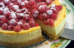 Raspberry and lemon chesecake. Dusted with icing sugar Royalty Free Stock Images