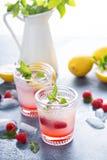 Raspberry lemon lemonade for summer days Stock Photos