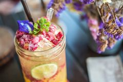 Raspberry and lemon soda on the table. Raspberry and lemon drink Royalty Free Stock Photography