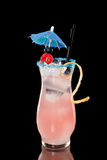 Raspberry lemonade. Refreshing raspberry lemonade isolate don a black background, with an umbrella and a twist Stock Images