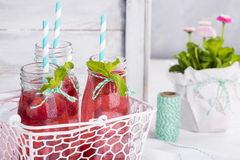 Raspberry lemonade freshness of summer. Water with raspberries in a transparent glass on a horizontal photo Stock Photos