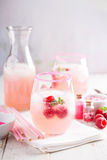 Raspberry lemonade in a glass Stock Photos