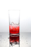 Raspberry lemonade with lce cubes in a glass Stock Photo