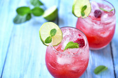 Raspberry lemonade with lime. Stock Photo
