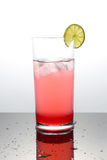 Raspberry lemonade with lime in a glass Royalty Free Stock Photos
