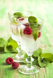 Raspberry lemonade with lime and mint Royalty Free Stock Image
