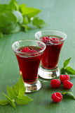 Raspberry liqueur. In glasses. . selective focus stock images