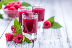 Raspberry Liqueur. With some fresh fruits in a glass Stock Photo