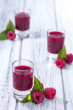 Raspberry Liqueur. With some fresh fruits in a glass Stock Photos