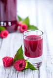 Raspberry Liqueur. With some fresh fruits in a glass Royalty Free Stock Image