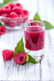 Raspberry Liqueur. With some fresh fruits in a glass Stock Photography