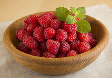 Raspberry. It is a lot of berries in a wooden bowl Royalty Free Stock Photo